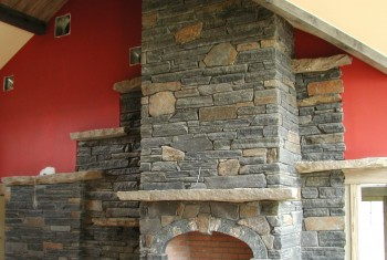 "6"" snapped fireplace with some wall stone on edge to add interest with stone mantel and shelves."
