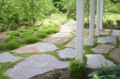 Patio stones with grass. By ForSeasons Landscape.