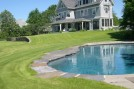 Patio stone edging pool. By ForSeasons Landscape.