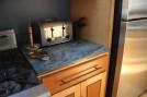 Crowsfoot countertop piece next to stove