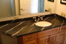 Polished vanity with natural edge