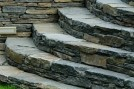 Steps pieced together using wall stone by Countryscapes