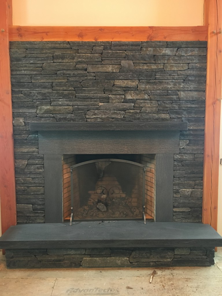 "snapped 4"" veneer and satin mantle, hearth and surround of Ashfield Schist work by Henry Jones Masonry"