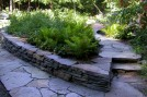 Patio and wall by Treefrog Landscape.